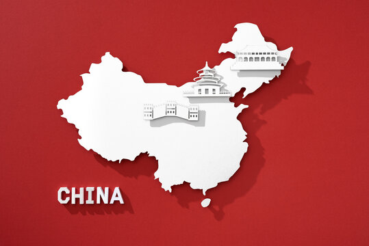 China map cutted from paper with nationals symbol. Travel concept.