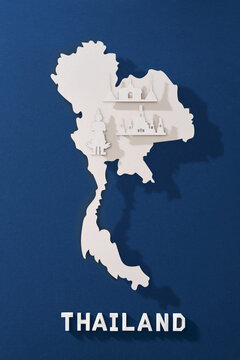 Thailand map cutted from paper with nationals symbol. Travel concept.