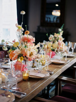 Dishware and decorations on banquet table