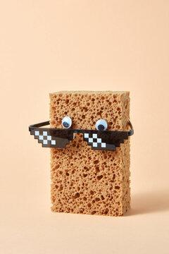 Pixel art glasses on a sponge.