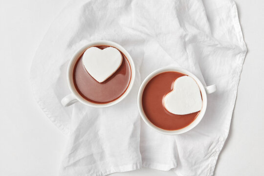 Heart cakes in two cups with chocolate.