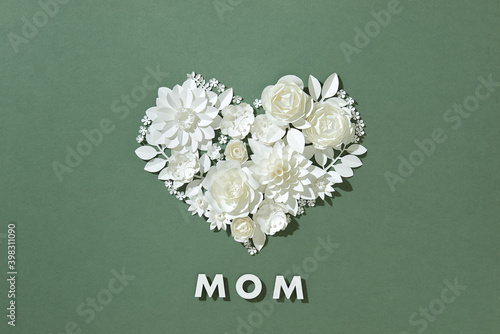 Happy mother day concept. With white paper flowers and leaves