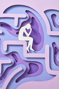 Close-up handmade paper thinker inside labyrinth of human brain.