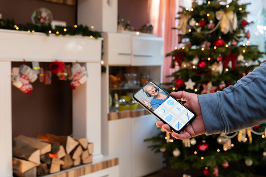 During the Corona Pandemic, the family doesnt get together at Christmas. The grandmother is online with the family via video call. The app is imaginary designed in neurophism look for old people.