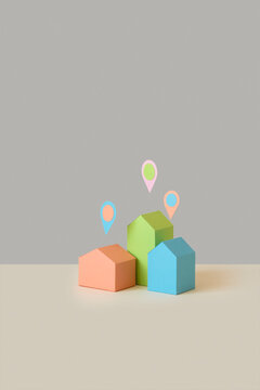 Papercraft colored houses with location pins.