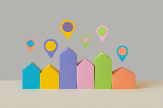 Papercraft colorful houses with location signs.
