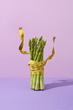 Asparagus banch with measuring tape.