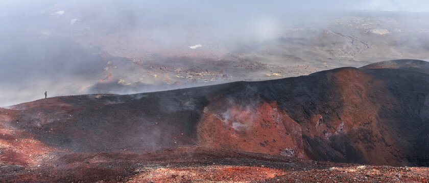 Panoramic view crater of Tolbachic volcano with man, Kamchatka Russia.