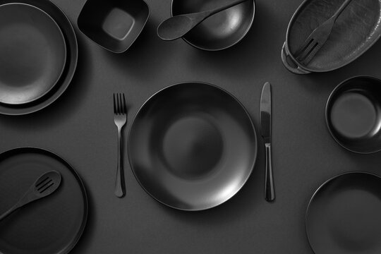 Served kitchen table with black cookware.
