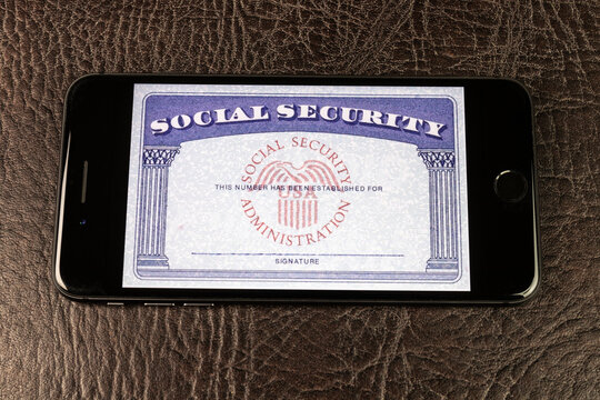 Indianapolis - Circa December 2020: Social Security card blank on a smartphone. The Social Security Administration oversees retirement, disability, and survivors benefits.