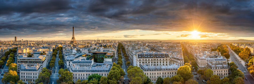 Aerial skyline panorama of Paris at sunset with view of the Eiffel Tower