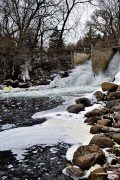 slightly frozen minnesota dam