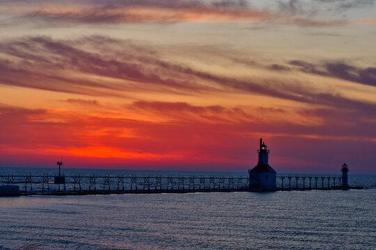 Sunset photo of the St Joseph Michigan North Pier Lighthouses and Lake Michigan