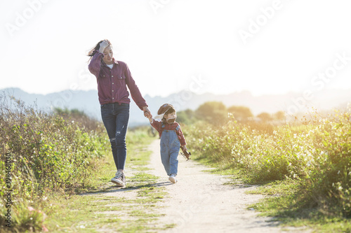 Mother's day concept, mother and daughter playing outdoors, growth concept