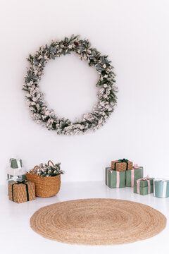 Christmas wreath with gifts in a white room