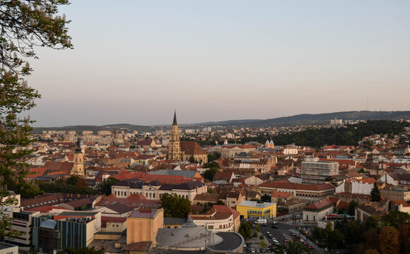 Cluj-Napoca,Romania- 07.20.2019: Aerial photography over the town center at the sunset. Sfantul Mihail Church,located in the center of the city,in Matei Corvin Square (Mathias Rex).