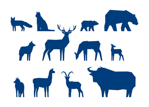 Set of low poly animals. Silhouettes of bear, deer, wolf, mountain goat, etc. Vector illustration