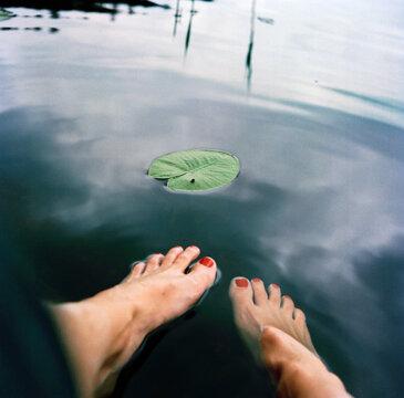 Womans feet in water