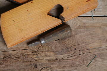 carpenter's tools lie on a wooden table clamp plane