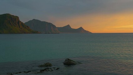 Wall Mural - Sunset over the mountains and the sea of Lofoten Islands, Norway