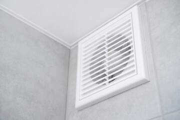 Fototapeta Home vent grille. Forced ventilation in a wall under the ceiling. obraz