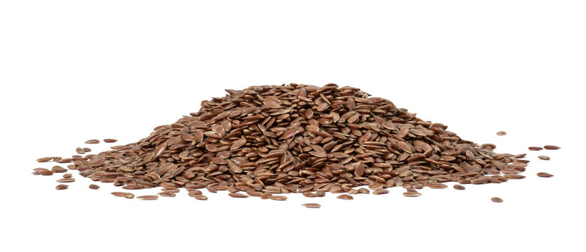 Large pile of linseed og flax seed seen from low angle and isolated on white background