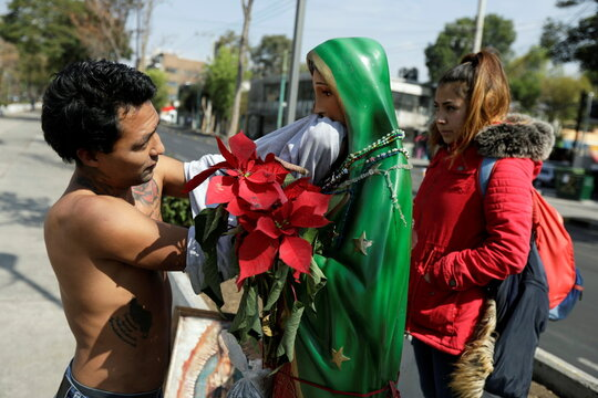 Faithful are see in the vicinity of the Basilica of Guadalupe entrance that is temporarily closed to avoid crowds on the traditional day of celebration of the Virgin of Guadalupe