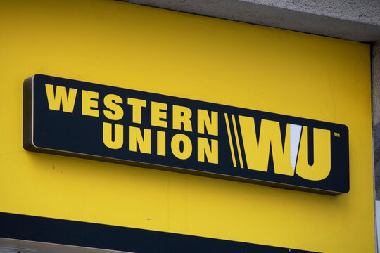 Western Union sign is yellow and black. He withdrew.
