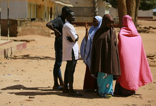 Family members of abducted students gather at the Government Science school after it was attacked by gunmen, in Kankara