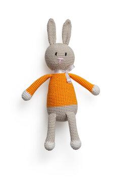 Isolated handmade rabbit children toy on white background