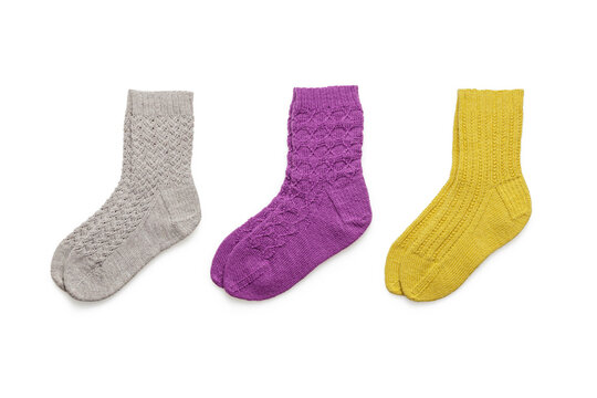 Clean isolated wool socks on white background top view