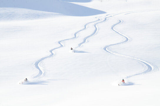 Snowmachine and rider in Alaskan backcountry.