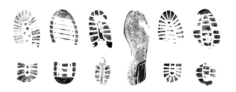 Muddy bootprints. Isolated on white background. Close up