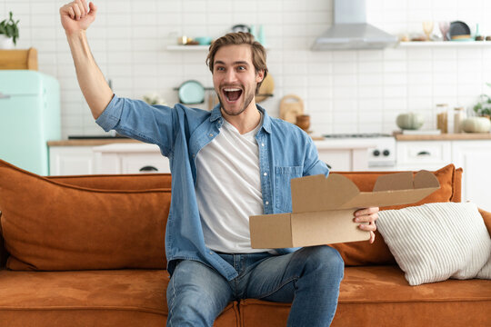 Happy man customer unpacking cardboard box receive open post mail delivery package