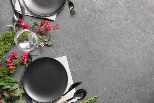 Beautiful Christmas table setting with mistletoe on dark background