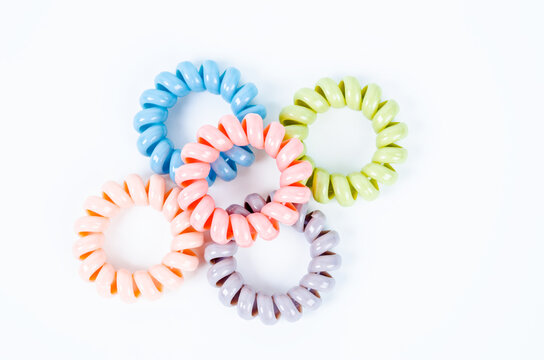 Group of colorful spiral rubber bands. Elastic hair ties in vibrant colors.