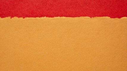abstract landscape in orange and red pastel tones - colorful handmade Indian papers produced from recycled cotton fabric