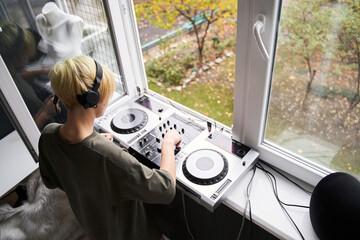 Fototapeta Female music producer with headphones obraz