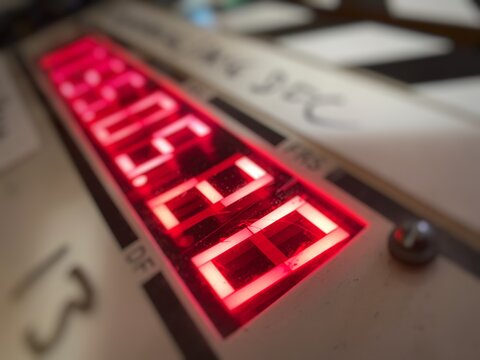 Macro detail of red timecode numbers on a film slate (clapperboard), extremely shallow depth of field