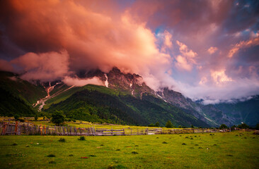 Wall Mural - Attractive sunset with colorful clouds at the foot of Mt. Ushba.