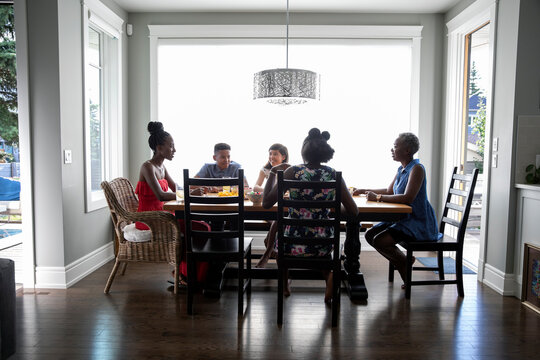Family having refreshments at dining table