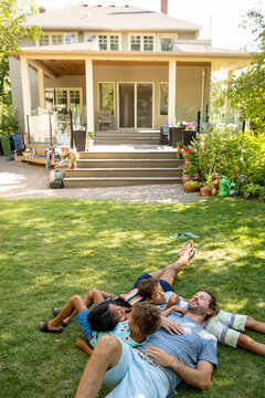 Family sleeping on lawn
