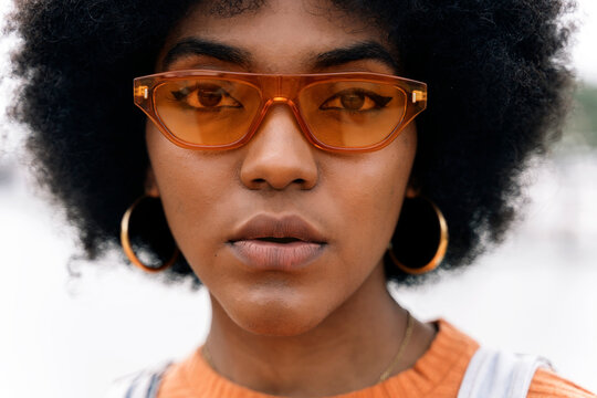 Afro Hairstyle Woman with orange sunglasses