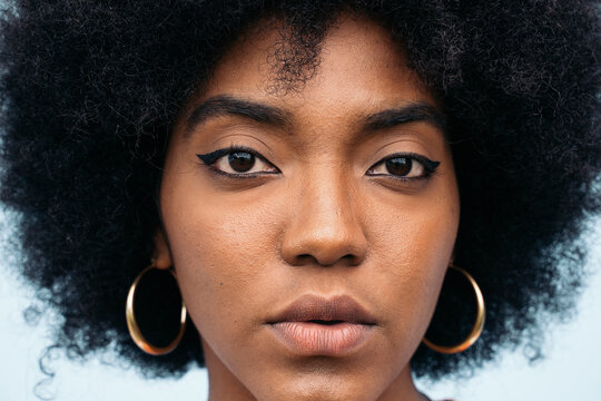 Close up of a pretty afro woman looking seriously at camera