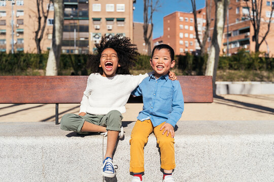 Multiethnic children laughing at the park.