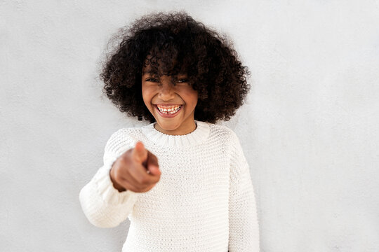 Cute afro kid laughing.