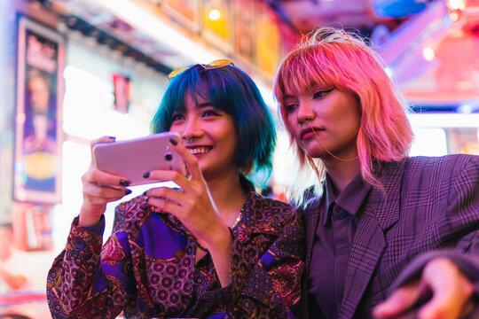 Alternative asian girls taking a selfie