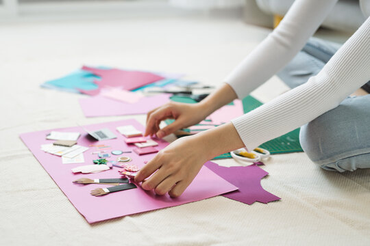 Female hands making craft paper works