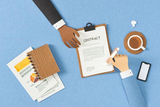 Businessman signing partnership agreement concept