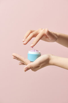 Moisturizing cream in female hands isolated. Beauty treatment.